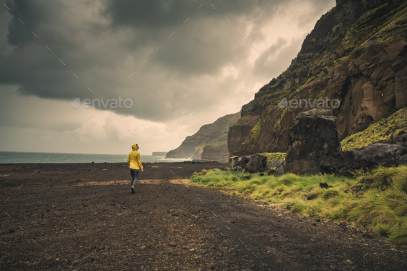 Walking over a wild beach - Stock Photo - Images