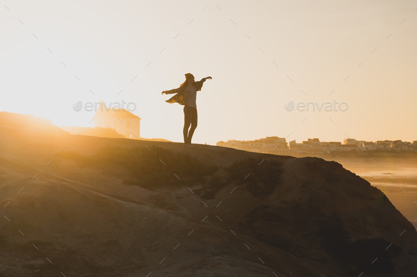 Woman over the cliff - Stock Photo - Images
