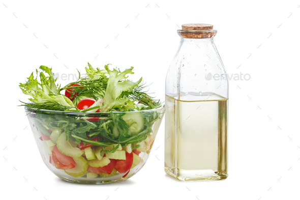 Bowl of salad  and olive oil - Stock Photo - Images