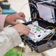 Technicians are installing fiber optic cabinets. - PhotoDune Item for Sale