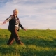 An Senior Woman Is Walking in Her Granddaughter. They Go Against the Backdrop of a Picturesque Rural - VideoHive Item for Sale