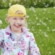 The Girl Is 6 Years Old Playing with Dandelions. He Waved His Hands, the Seeds Flew in All - VideoHive Item for Sale