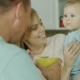 Young Parents Are Feeding Their Baby Boy. In Bright Modern Kitchen - VideoHive Item for Sale