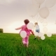 Two Carefree Little Girls Are Happy with the Arrival of Spring, They Run Along a Green Meadow with - VideoHive Item for Sale