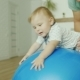 Dad Plays with His Young Son at Home. They Jump on a Massage Ball - VideoHive Item for Sale