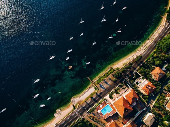 Aerial view from above to the marina with yachts on a sunny day in Italy - Stock Photo - Images