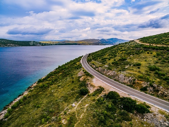 Aerial view of mountain road near the turquoise sea in summer Croatia. - Stock Photo - Images