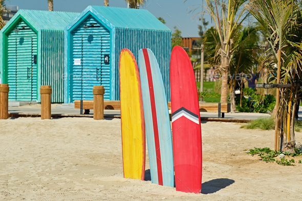 Surfboards and bathing cabins in Dubai - Stock Photo - Images