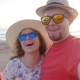Traveling Couple Taking a Selfie on Phone at the Beach - VideoHive Item for Sale