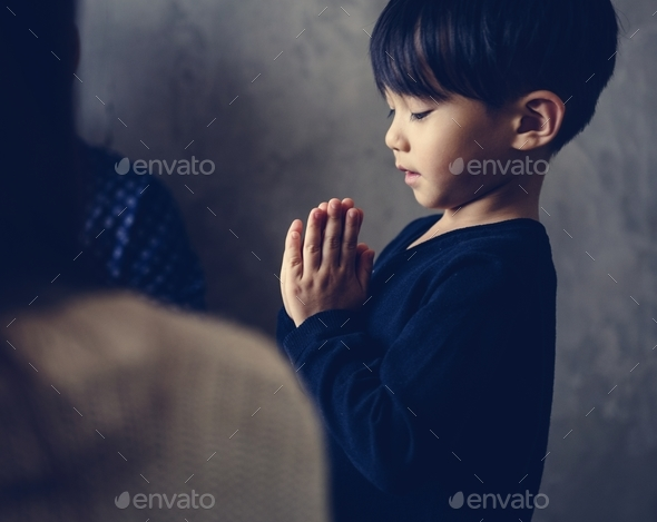Japanese boy praying - Stock Photo - Images