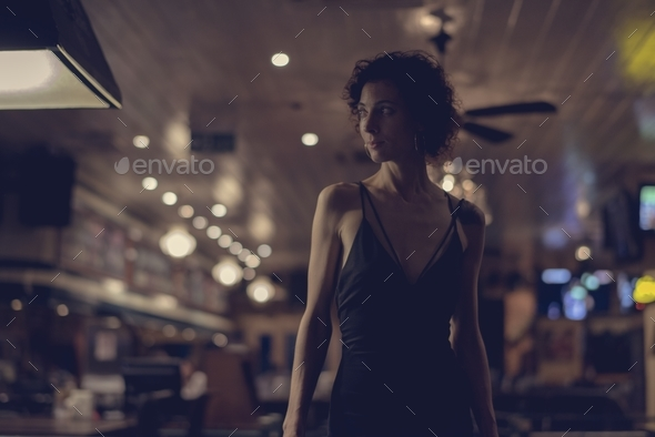 Portrait of a lone woman at a bar - Stock Photo - Images