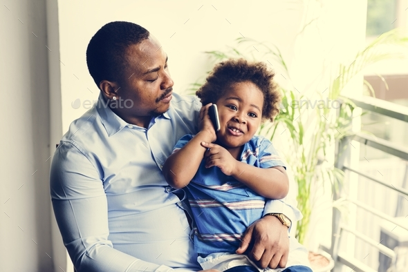 Black father enjoy precious time with his child together happiness - Stock Photo - Images