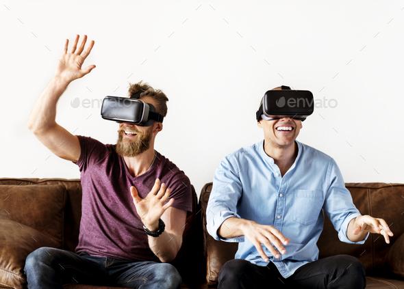 Men enjoying VR - Stock Photo - Images