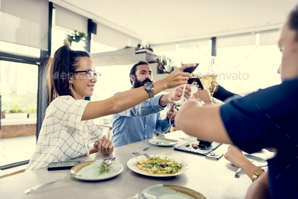 People cheers a wine glasses together - Stock Photo - Images