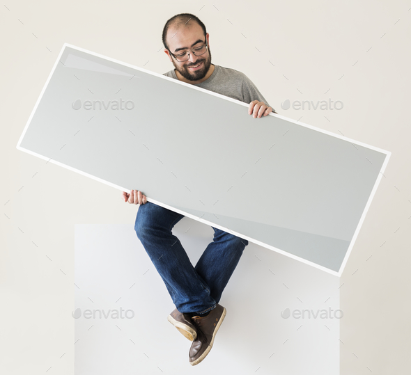 Man holding a blank banner - Stock Photo - Images