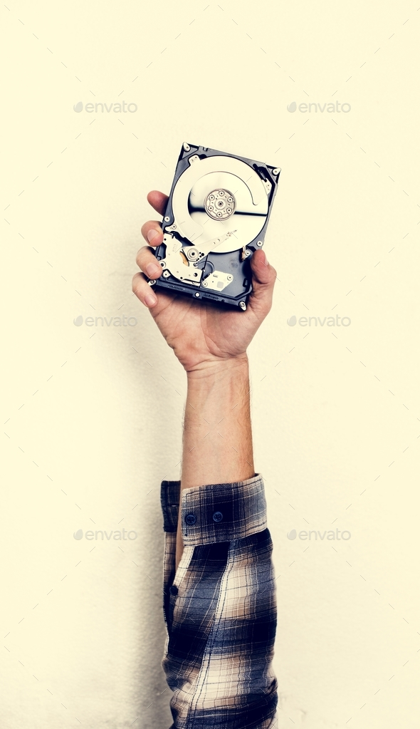 Hand holding computer hard disk drive isolated on white - Stock Photo - Images