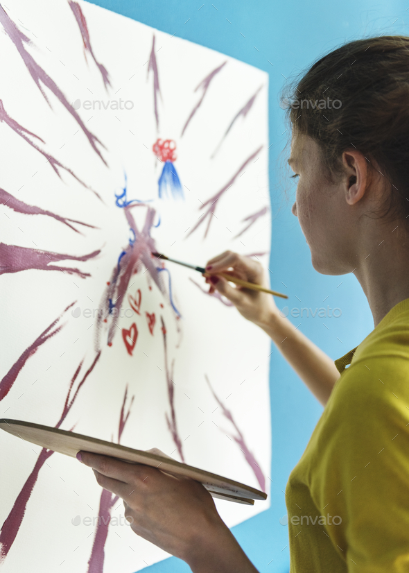 Young artist creaiting an artwork - Stock Photo - Images