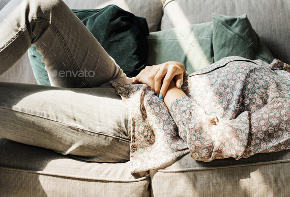 Young woman lying on the couch - Stock Photo - Images
