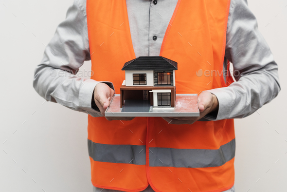 Contractor in a safety vest - Stock Photo - Images
