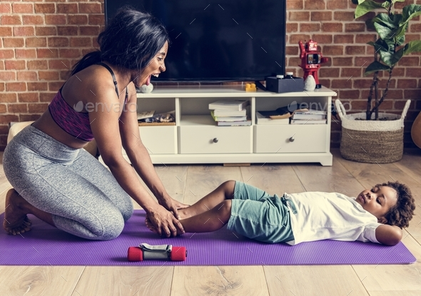 Mom and son workout at home - Stock Photo - Images