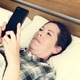 A woman using a mobile phone in bed - PhotoDune Item for Sale