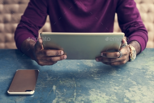 African man using digital tablet - Stock Photo - Images