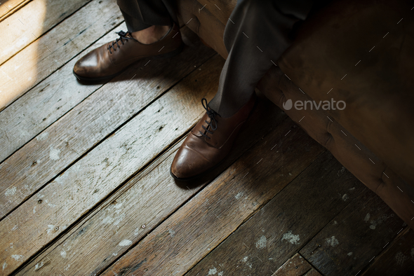 Leather shoes on wooden floor - Stock Photo - Images