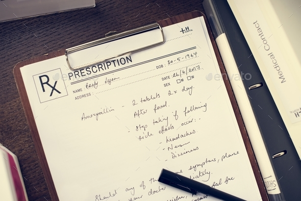 Doctor wrote a patient prescription - Stock Photo - Images
