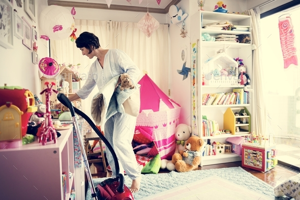 Mother cleaning daughter's room - Stock Photo - Images