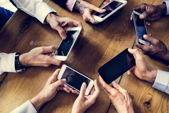 People hands using smartphone in a meeting - Stock Photo - Images