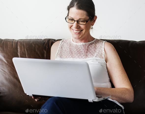 White woman using laptop - Stock Photo - Images