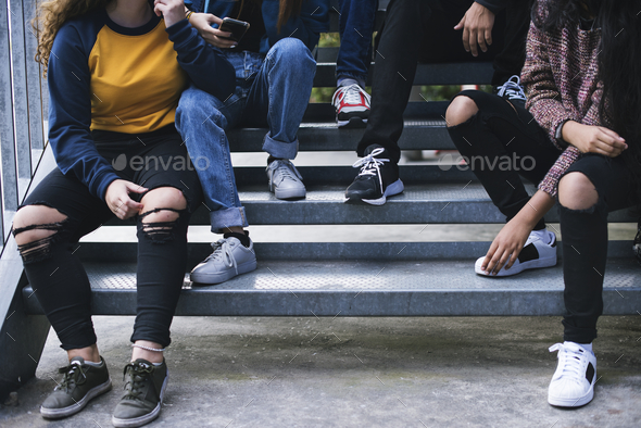 Group of school friends outdoors lifestyle and after school hangout concept - Stock Photo - Images