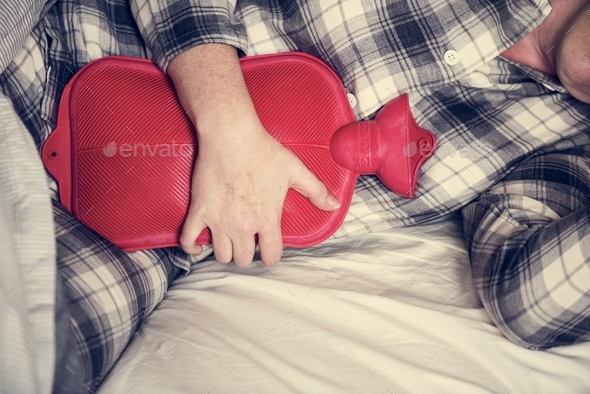 Caucasian woman having painful period cramps - Stock Photo - Images