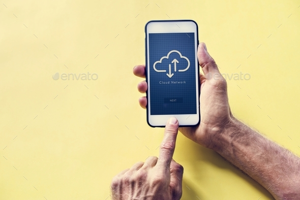 Hands holding a smartphone with cloud network on screen - Stock Photo - Images