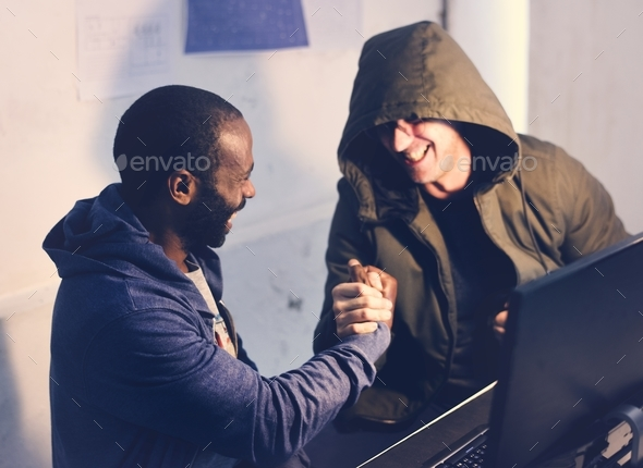 Diverse friends holding hands together - Stock Photo - Images