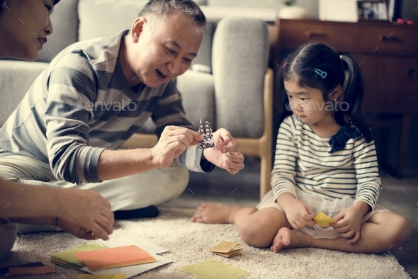 Grandparent palying with niece at home - Stock Photo - Images