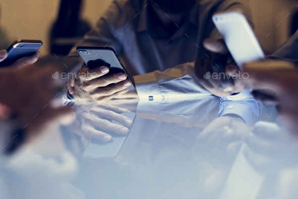 Hand holding smartphone sitting together - Stock Photo - Images