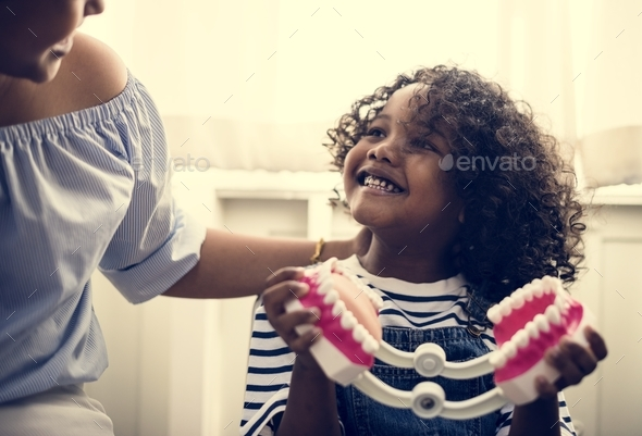 Young kid is meeting a dentist - Stock Photo - Images
