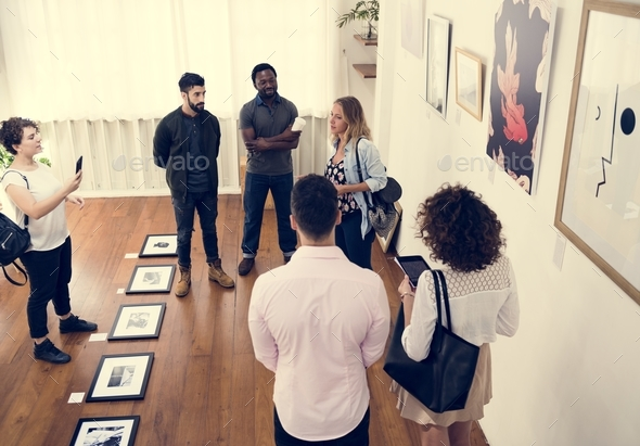 People in an art exhibition - Stock Photo - Images