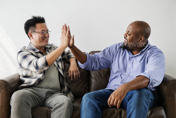 Men joining hands together - Stock Photo - Images