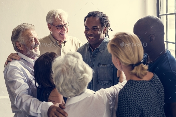 Group of diverse people giving each other support - Stock Photo - Images