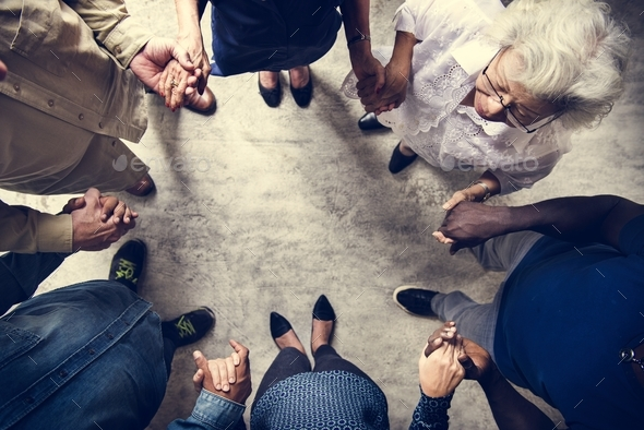 Group of diverse hands holding each other support together teamwork aerial view - Stock Photo - Images
