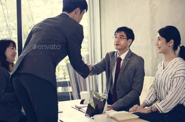 Japanese businessmen having an agreement - Stock Photo - Images