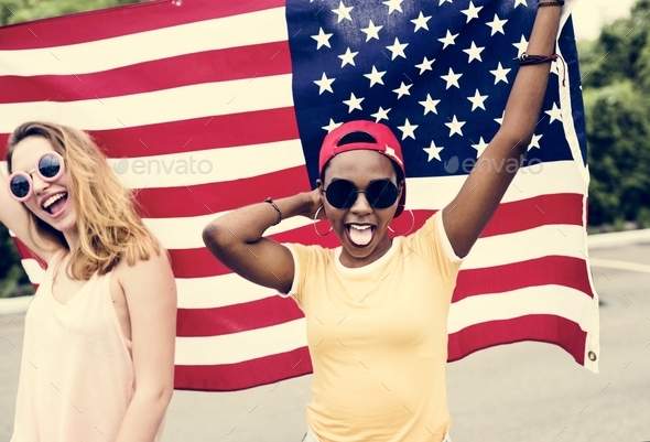 Young women with American flag - Stock Photo - Images