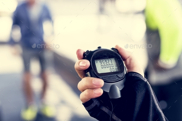 Closeup of hand holding stopwatch - Stock Photo - Images