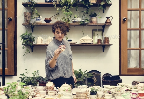Woman choosing some tea cups - Stock Photo - Images