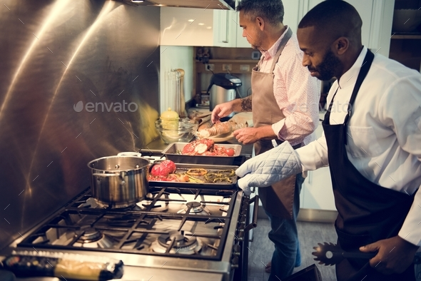 Two men cooking in a kitchen - Stock Photo - Images