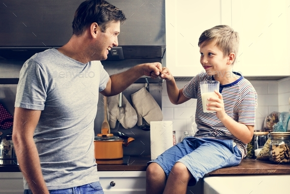 Father and son in kitchen - Stock Photo - Images