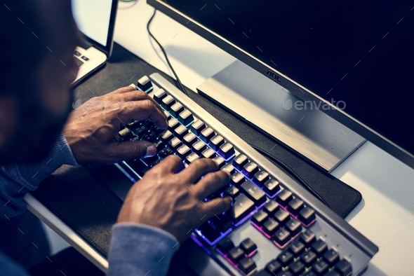 Hacker using keyboard typing phishing on the internet - Stock Photo - Images