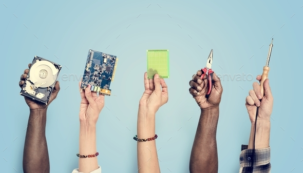 Hands holding digital component isolated on background - Stock Photo - Images